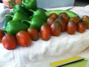 Here are some Purple Rusian tomatoes in repose with bell peppers and cucumber.