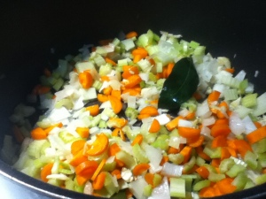 Aromatics, assemble! I use all of them- onion, garlic, celery, carrots, and a big old bay leaf. Sweat it all down with just a little sprinkle of salt, it takes about 15 minutes or so.