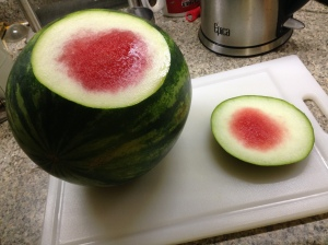 With the utmost care, take a slice off the side of the melon to create a flat surface.