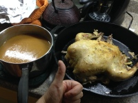 Chicken, cooked and accompanied by gravy made from the crock pot drippin's.
